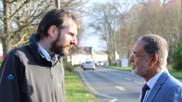 Alain Dekker and Cllr Abul Koher Chowdhury discuss the effect of Conservative cuts on local groups. (Rushmoor Liberal Democrats)