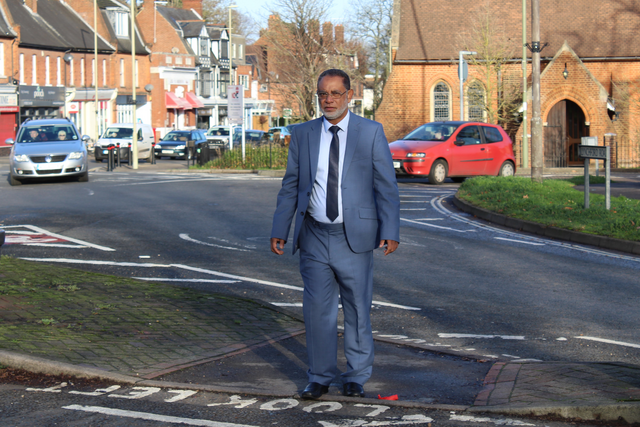 Cllr Abul Koher Chowdhury trying to cross Lynchford Road at St. Alban's roundabout (Rushmoor Liberal Democrats)