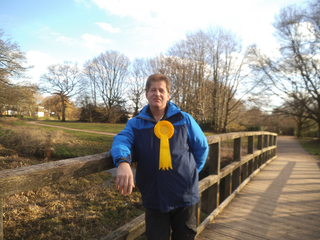 Craig Card wearing a yellow Liberal Democrat rosette